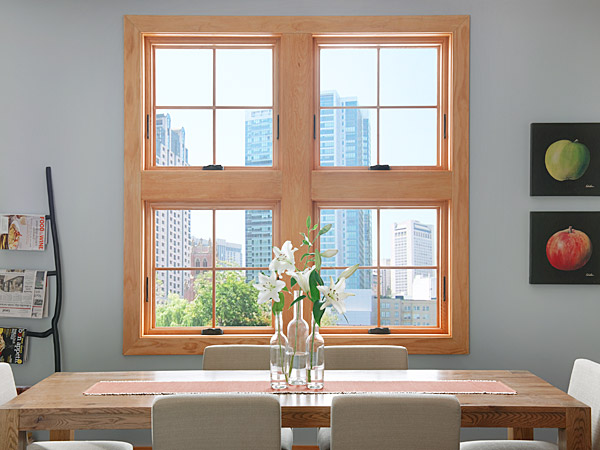 Wood windows can be sourced locally as discussed on the Hatch Blog - LOCALLY MANUFACTURED BUILDING MATERIALS PART 6: DOORS AND WINDOWS